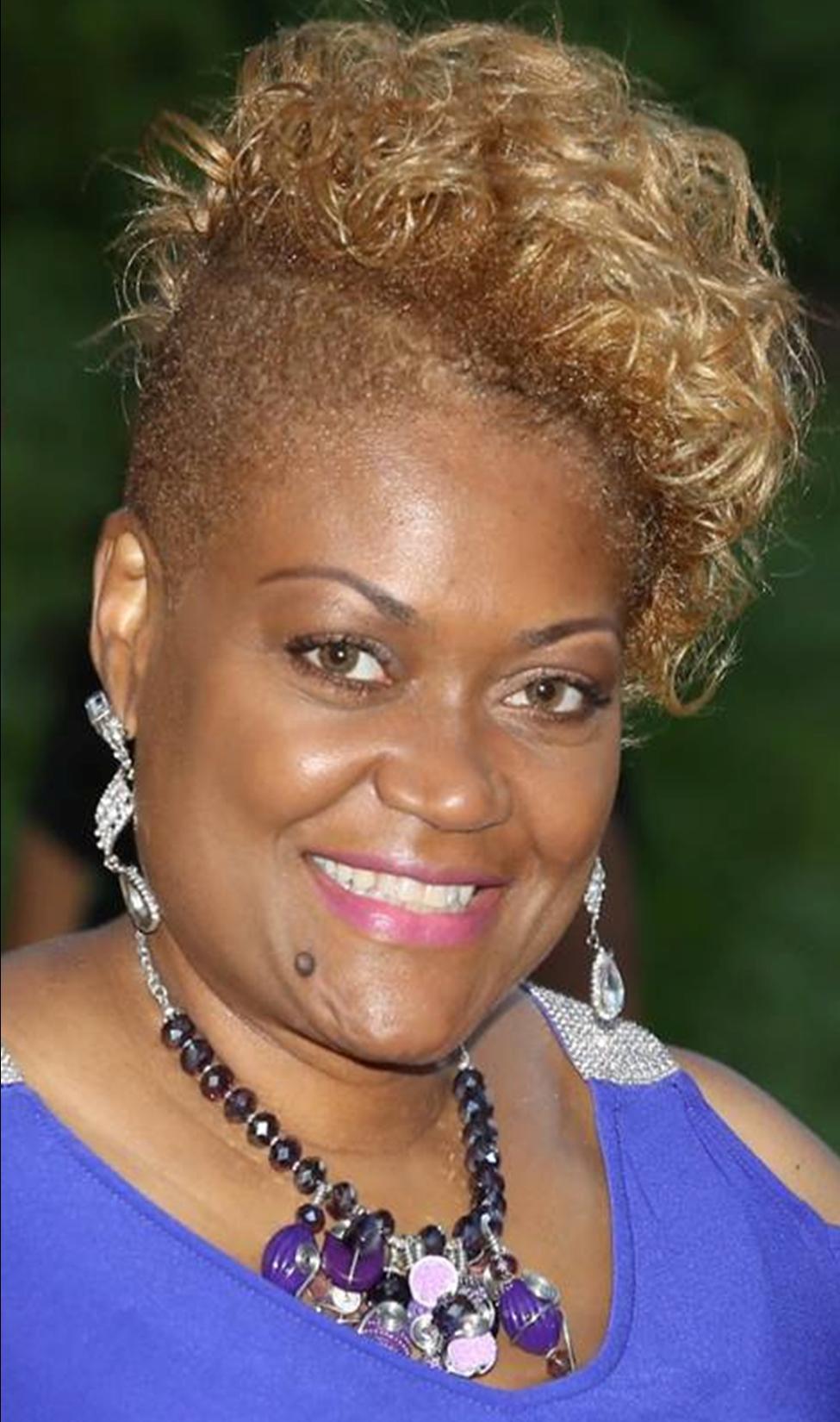 Dr Toni Hatton Headshot Blue Dress